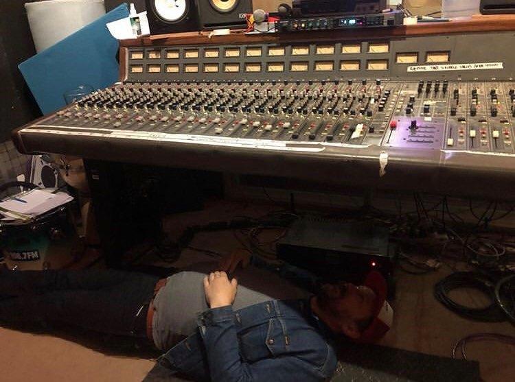 Paul Maybury under the desk.
